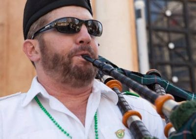 beard playing bagpipe